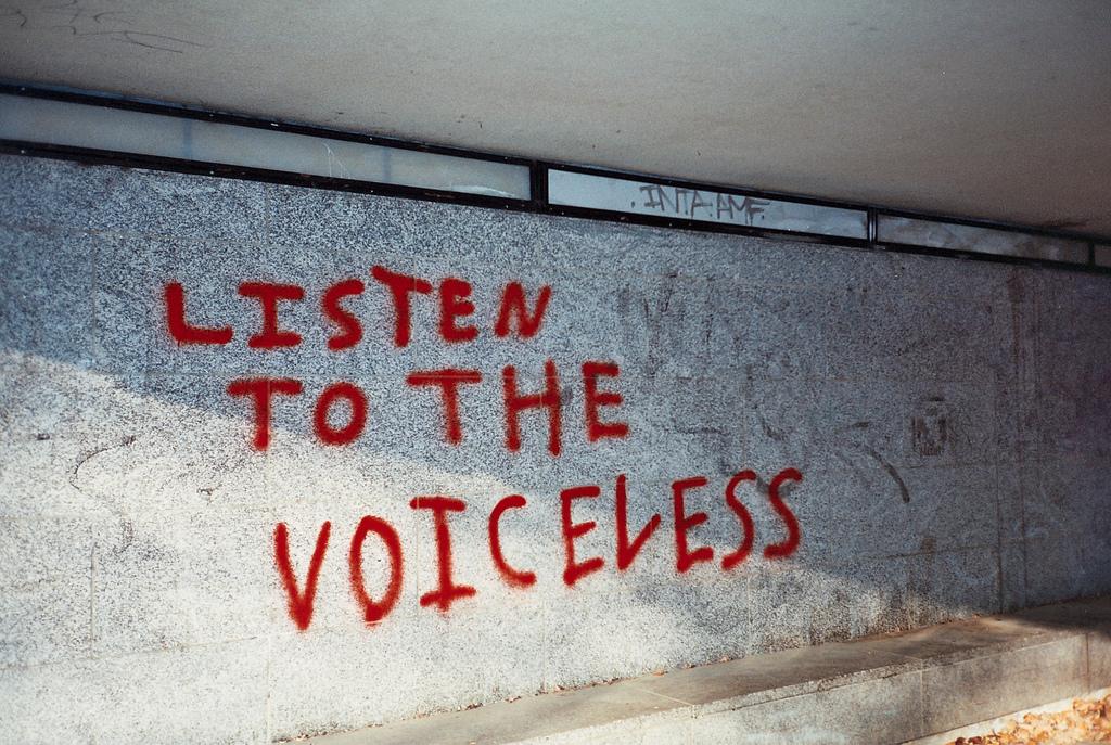 Sarah Joy Listen to the voiceless  Subway graffiti, Central Milton Keynes. dec 2011 https://creativecommons.org/licenses/by-sa/2.0/